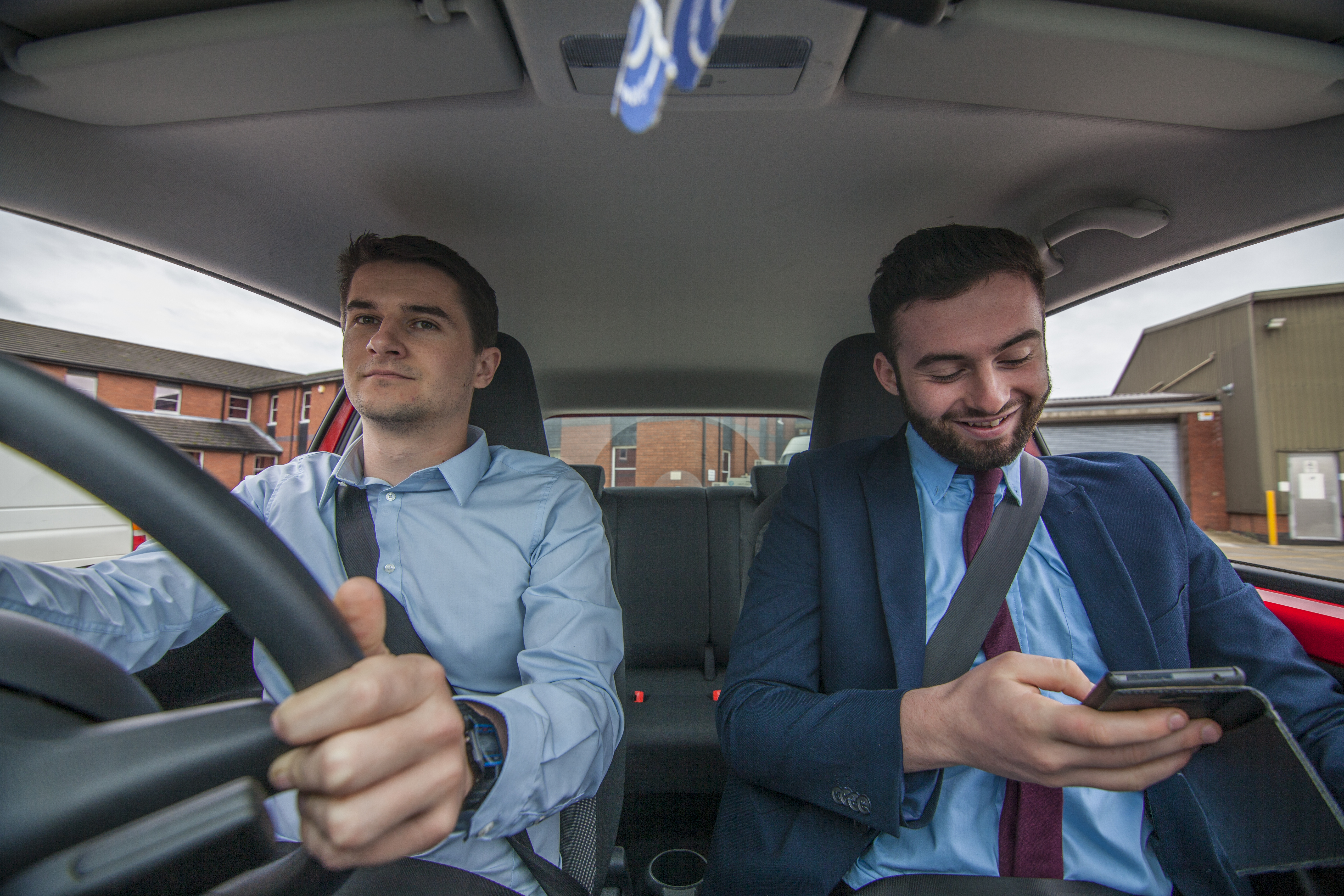 Businessmen From The Dashboard